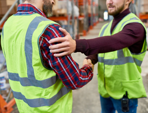 SVSR - Two warehouse workers patting each other on back