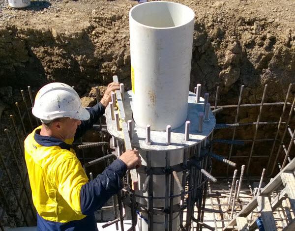 A man installing vent shaft safely