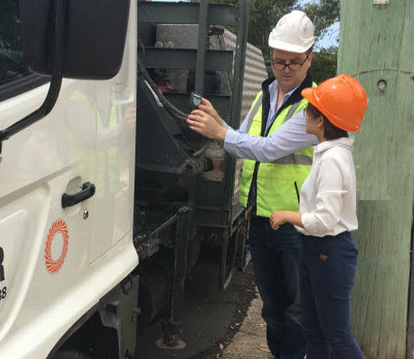 Two workers talking to each other